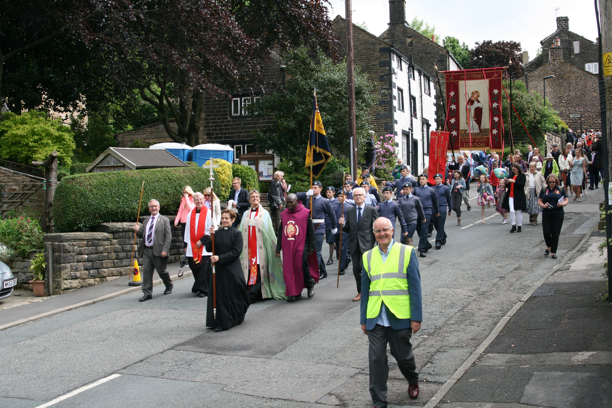 Procession down street for Whit walk