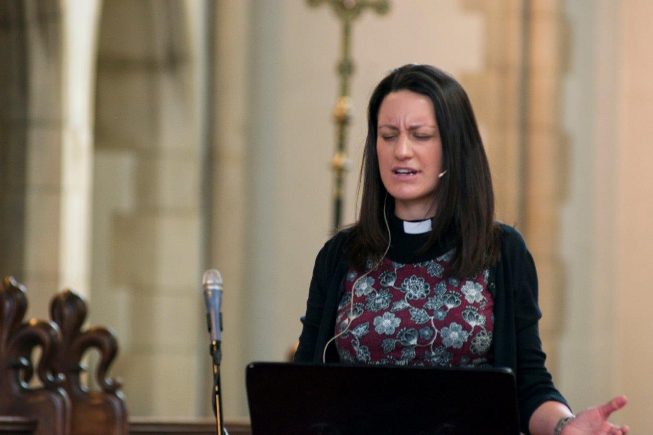 Woman curate preaching