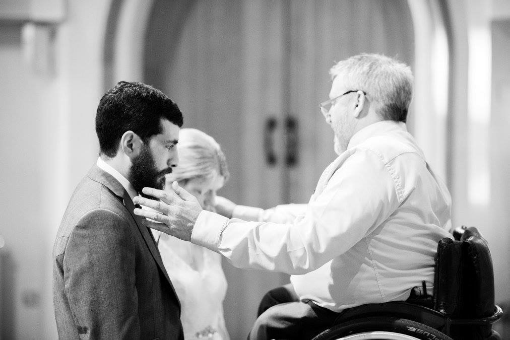 Vicar in a wheelchair presiding over a marriage ceremony