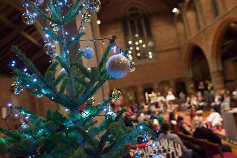 A close up of a Christmas tree at a Crib Service