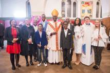 Confirmed church members standing with Bishop in church