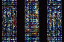 Close up of three panes of stained glass