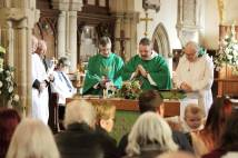Priests praying during Holy Communion at St Catherine's Burbage
