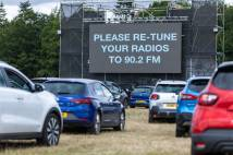 Cars are told to tune their radios to a FM frequency on a big cinema screen