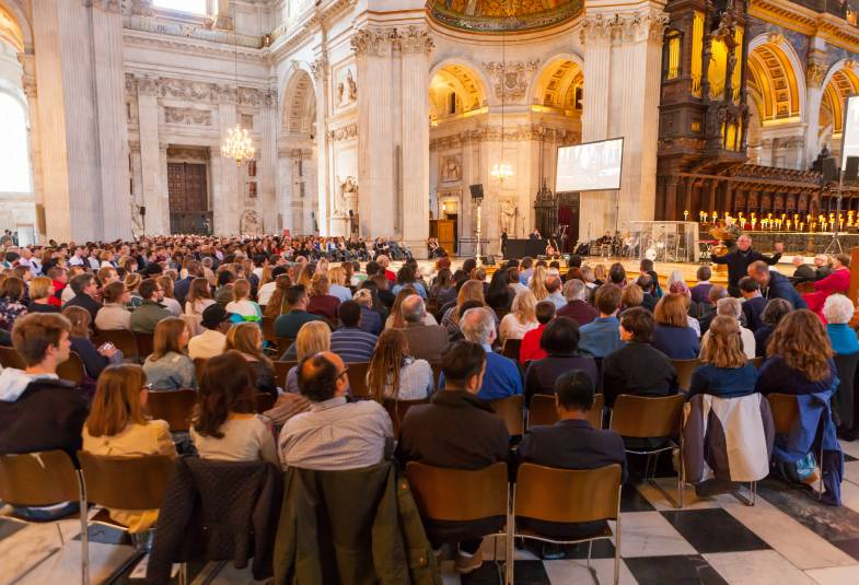 filled seats at service taking place inside St Paul's Cathedral