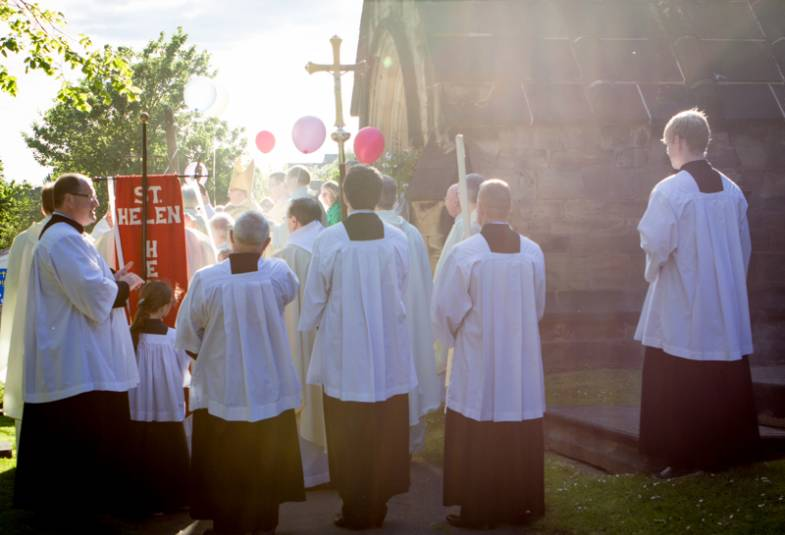 procession entering church, people wearing surplice