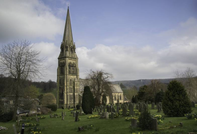 Exterior view of St Peter's church, Edensor and graveyard