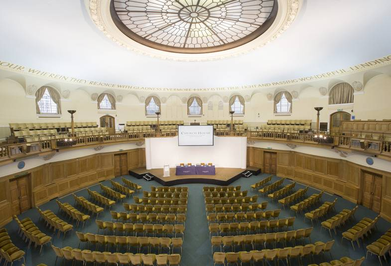 Assembly Hall in Church House set up with chairs for conference
