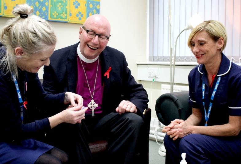 Bishop of Liverpool with two nurses in clinic