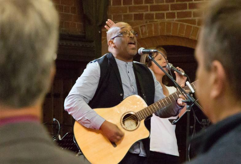 Man playing guitar in church service
