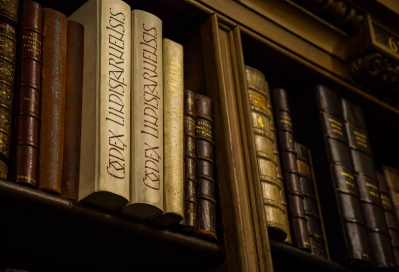 Close up of old bound books in a bookshelf