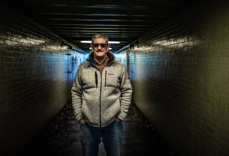Man wearing sunglasses and standing in a tunnel