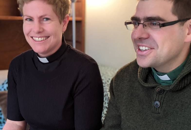 The ordained pair smile at the camera