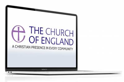 The Church of England logo on a laptop.