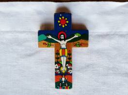 Colourful Romero cross laying on white cloth