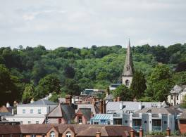 Church spire in distance, with trees and buildings