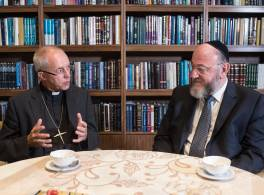 Archbishop Justin Welby and Chief Rabbi having tea at table