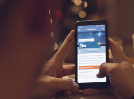 A man uses the #FollowTheStar app on an iPhone.