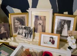 Close up of a display of old photos capturing different special moments throughout a lady's life