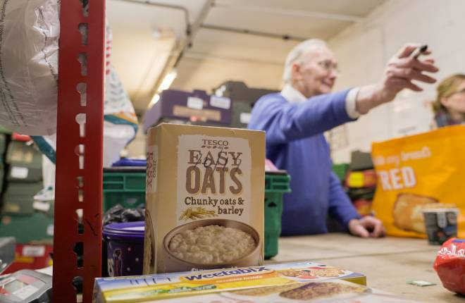 Cereal box in foodbank, volunteers in the background