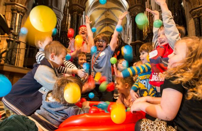 children play in ball pool inside cathedral